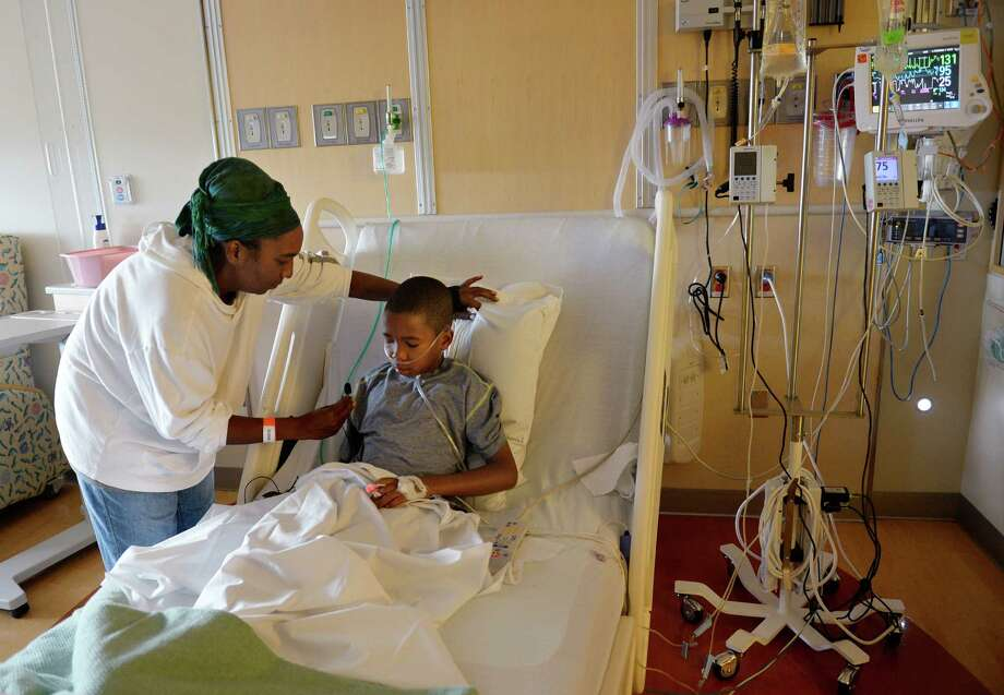 Melissa Lewis, of Denver, took her son, Jayden Broadway, 9, to the hospital after he contracted enterovirus 68. His asthma made the illness more difficult to fight. Photo: Cyrus McCrimmon, MBR / The Denver Post