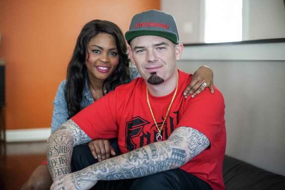Crystal and Paul Wall pose for a portrait in their home Friday October 24, 2014 in Houston, TX. The couple has collectively lost 160 pounds. (Michael Starghill, Jr.)