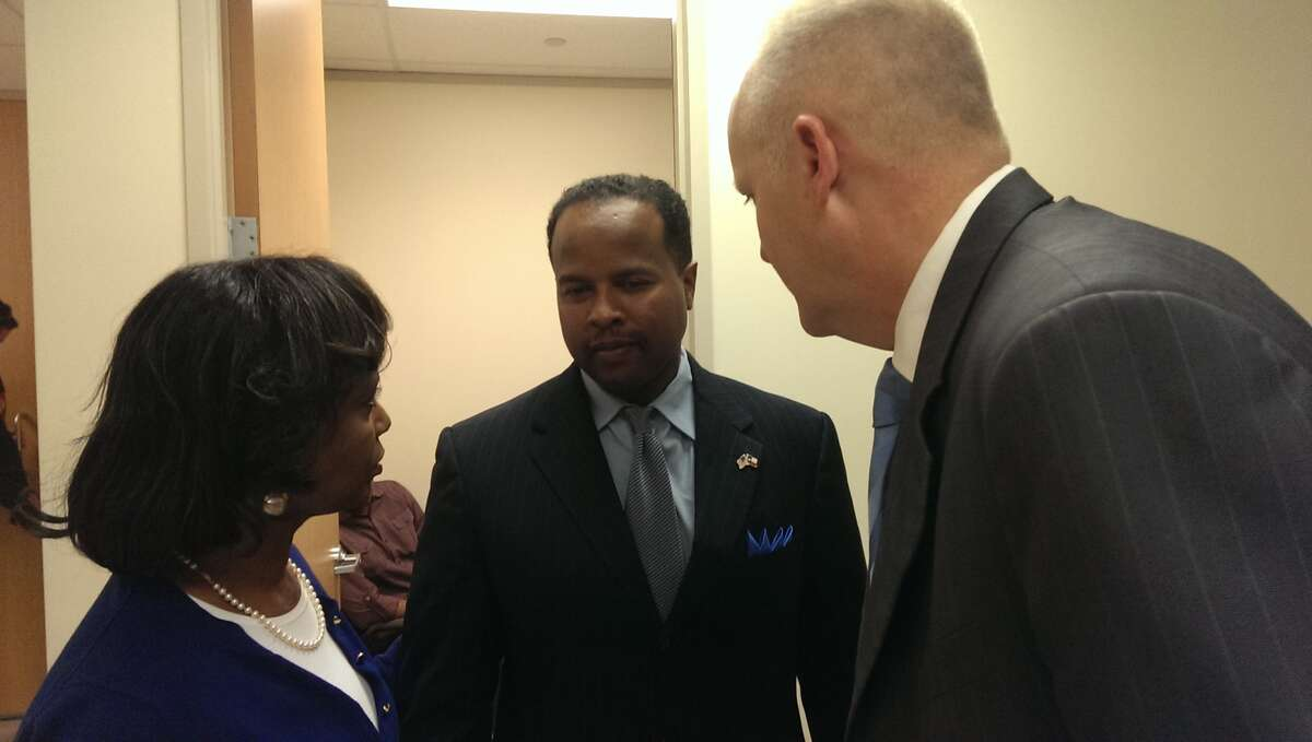 Reynolds talks with his attorneys Vivian King and Stephen Jackson after his conviction on Friday in Montgomery County.