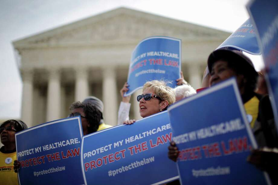 FILE - In this March 28, 2012 file photo, supporters of health care reform rally in front of the Supreme Court in Washington on the final day of arguments regarding the health care law signed by President Barack Obama. The Supreme Court agreed Friday to hear a new challenge to President Barack Obama's health care law. The justices said they will decide whether the law authorizes subsidies that help millions of low- and middle-income people afford their health insurance premiums.  (AP Photo/Charles Dharapak, File) Photo: Charles Dharapak, STF / AP