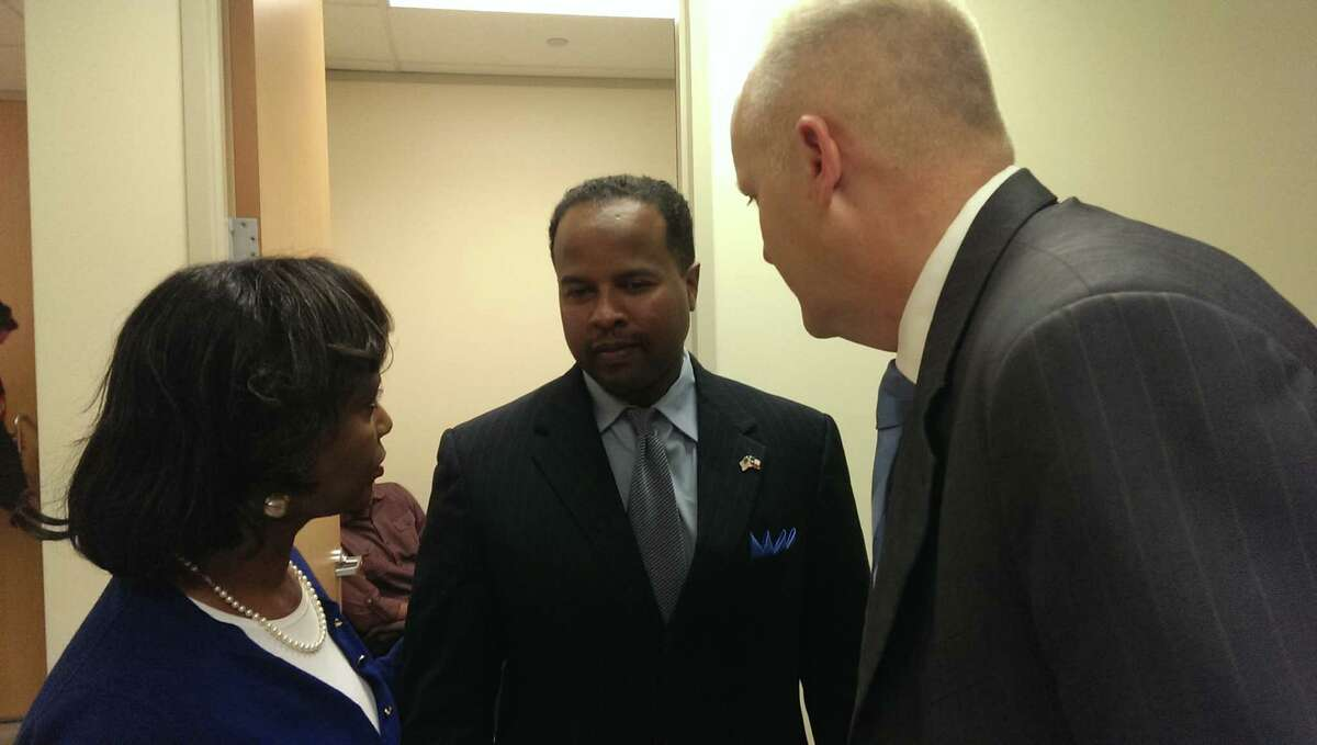State Rep. Ron Reynolds talks with his attorneys Vivian King and Stephen Jackson after his conviction on six counts of misdemeanor solicitation of professional conduct, a lesser charge than the felony barratry charge he faced.