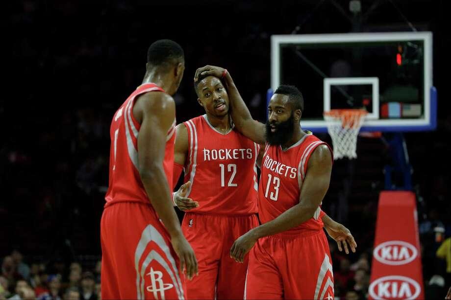 Houston Rockets' Dwight Howard (12) and James Harden (13) celebrate during an NBA basketball game against the Philadelphia 76ers, Monday, Nov. 3, 2014, in Philadelphia. (AP Photo/Matt Slocum) Photo: Matt Slocum / Associated Press / AP