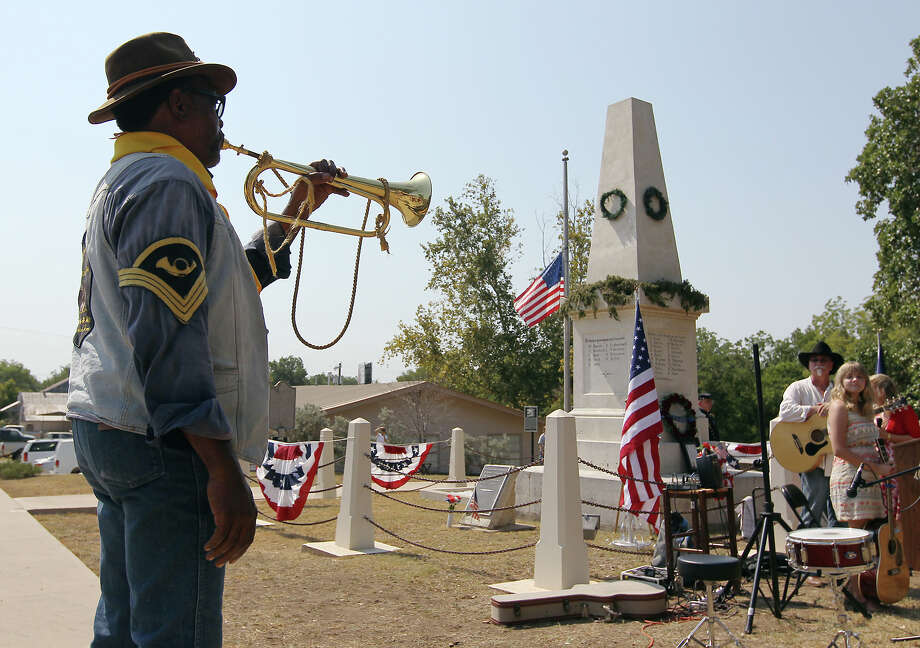 Richard Steen, a member of the Bexar County Buffalo Soldiers, plays taps during a ceremony to mark the 150th anniversary of the Battle of Nueces at the Treue der Union monument in Comfort, Texas on Saturday, August 11, 2012. The monument and the anniversary commemorates the German Texans who supported the Union, opposed slavery and died after objecting to being drafted into the Confederate Army. 34 German Texans, while fleeing, were killed in a clash with Confederate soldiers near the Nueces River. Photo: Kin Man Hui / Kin Man Hui / SAN ANTONIO EXPRESS-NEWS / ©2012 San Antonio Express-News