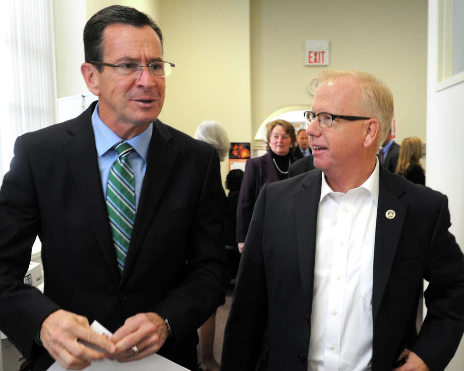Gov. Dannel Malloy and Danbury Mayor Mark Boughton arrive at a meeting at the Greater Danbury Chamber of Commerce, in Danbury, Conn. Oct. 31, 2014. Praxair Inc. announced they will keep their world headquarters in Danbury, and will invest $65 million to build a new 100,000 square foot corporate facility. Photo: Ned Gerard / Connecticut Post