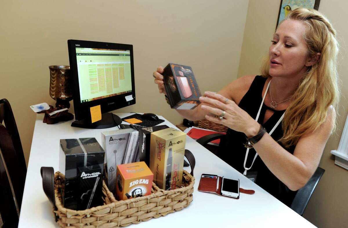 Karen Barski, of Trumbull, Conn. a co-ownerof the Compassionate Care Center of Connecticut, displays some of the vaporizors that she offers her customers. The Compassionate Care Center of Connecticut, a medical marijuana dispensary is opening in Bethel, Conn.