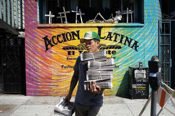 Johnny Garcia carries copies of El Tecolote to his car on August 14, 2014 in San Francisco, Calif. Garcia parks his car full of papers along his route and then delivers issues on foot, using a hand truck, in a process that takes several days.