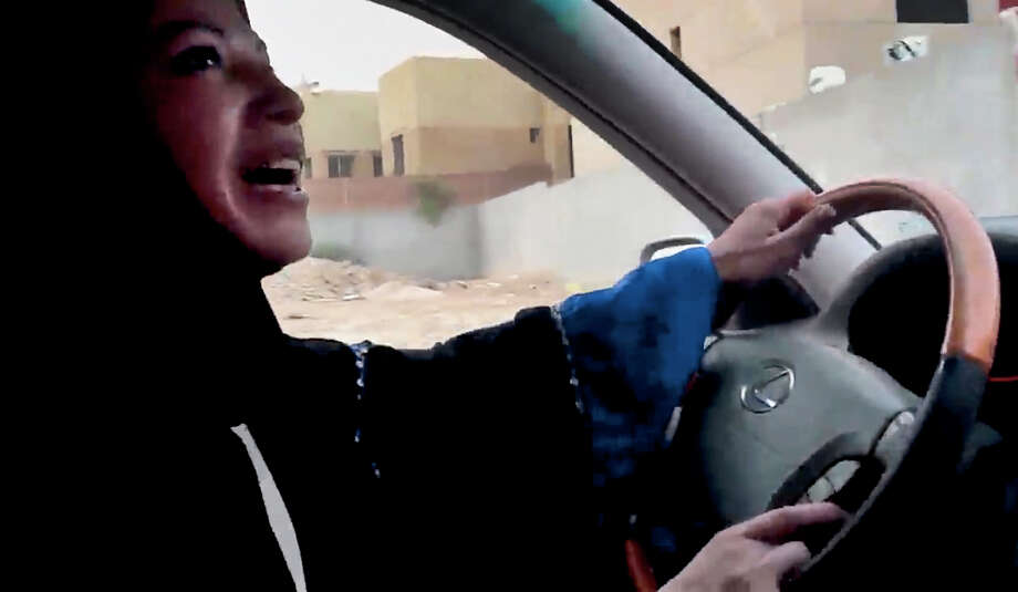 A Saudi Arabian woman drives a car as part of a campaign to defy Saudi Arabia's ban on women driving, in Riyadh, Saudi Arabia. A Saudi official said Friday that the kingdom's advisory council has recommended the partial lifting of the ban. Photo: Uncredited, HOPD / Change.org