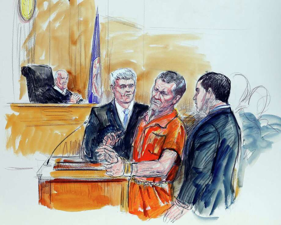 This artist rendering shows Irek Hamidullin, front center, his attorney Robert Wagner, front left, and interpreter Ihab Samra, front right, as judge Henry Hudson, left, listens in Federal Court in Richmond, Va., Friday, Nov. 7, 2014.   Hamidullin is charged with leading a Taliban attack against U.S. forces in Afghanistan.  He pleaded not guilty to terrorism charges in Federal Court.  (AP Photo/Dana Verkouteren) Photo: Dana Verkouteren / Associated Press / FRE 31454 AP