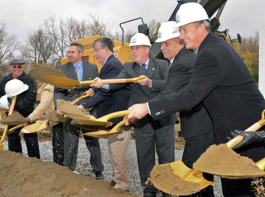 Managing director for RBC William Hoblock, right, joins dignitaries during ground breaking ceremonies for Residences at Lexington Hills Friday Nov. 7, 2014, in Cohoes, NY.  (John Carl D'Annibale / Times Union) Photo: John Carl D'Annibale / 00029362A