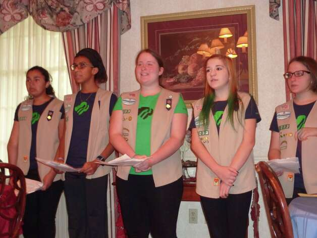 Katie Mendez, Amelia Chikota, Lucy Fitzpatrick, Samantha Morrison, and Ellie Fitzpatrick of Girl Scout Troop 1033 sing to veterans and their families at Fisher House, Stratton VA Medical Center, Albany. (Submitted photo)