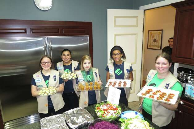 Ellie Fitzpatrick, Katie Mendez, Samantha Morrison, Amelia Chikota, and Lucy Fitzpatrick hold trays of hors d'oeuvres for military and veterans' families at Fisher House, Stratton VA Medical Center, Albany. (Submitted photo)