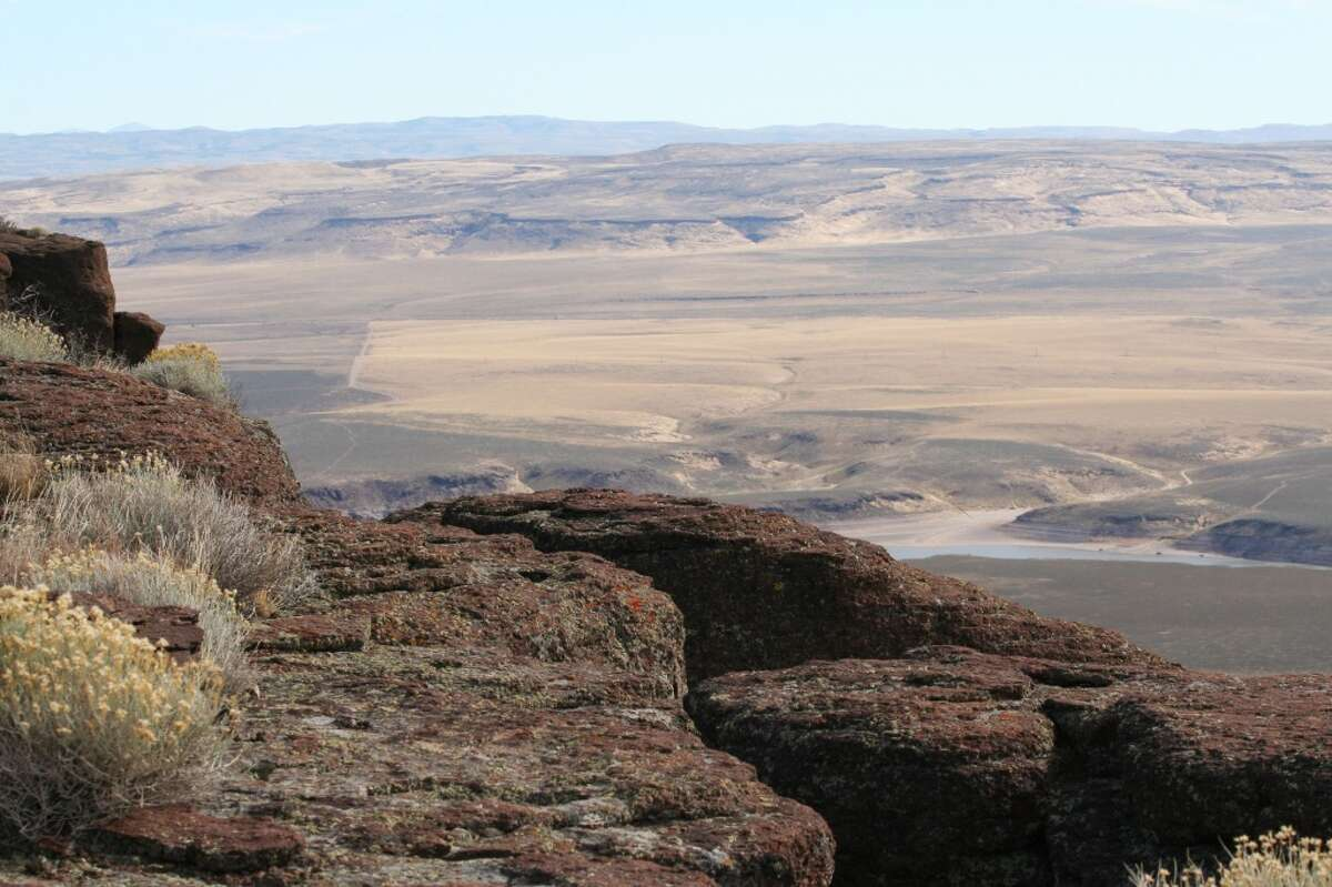 This photo provided by the Bureau of Land Management, shows an area in Rogerson, Idaho, on Tuesday, Oct. 14, 2014, with a sage grouse habitat. The challenges in keeping sage grouse off the endangered species list are complex but not unsolvable, the secretary of the U.S. Department of the Interior said. (AP Photo/Bureau of Land Management)