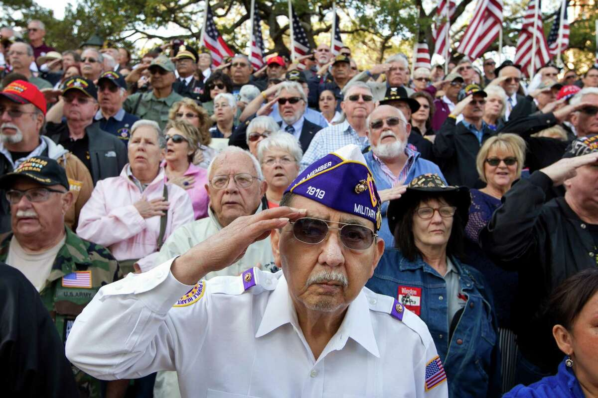 Vietnam veteran Frank Cortez salutes during the national anthem at the dedication of the Texas state Capitol Vietnam Veterans Monument in Austin, Texas, Saturday March 29, 2014. The dedication marks the 41st anniversary of the last U.S. troops leaving South Vietnam. About a half-million Texans served in the war, with more than 3,400 losing their lives and 105 still missing in action. (AP Photo/Austin American-Statesman, Jay Janner)
