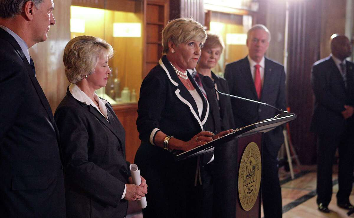 Fort Worth Mayor Betsy Price speaks as Dallas Mayor Mike Rawlings, left, Houston Mayor Annise Parker, second from right, and Texas Central High-Speed Railway (TCR) President Robert Eckels, right, look on during a press conference on the proposed rail line which will move people between Dallas/Fort Worth and Houston in about 90 minutes at Houston City Hall Thursday, March 27, 2014, in Houston. ( James Nielsen / Houston Chronicle )