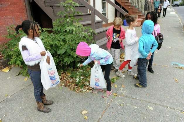 First and second graders collect found items in the neighborhood to build a fairy house on Wednesday, Nov. 5, 2014, at The Free School in Albany, N.Y. (Cindy Schultz / Times Union) Photo: Cindy Schultz / 00029346A