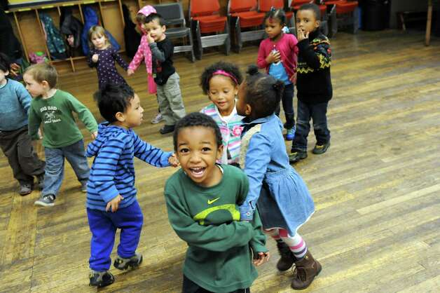 Preschoolers burn off energy as they wait to go outside to play on Wednesday, Nov. 5, 2014, at The Free School in Albany, N.Y. (Cindy Schultz / Times Union) Photo: Cindy Schultz / 00029346A