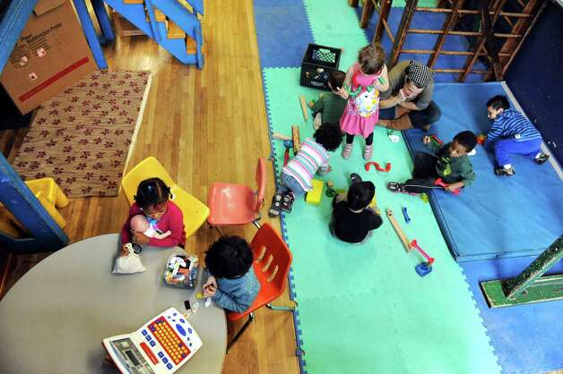 Preschool teacher Andre Castagneto, top right, watches over her charges on Wednesday, Nov. 5, 2014, at The Free School in Albany, N.Y. (Cindy Schultz / Times Union) Photo: Cindy Schultz / 00029346A