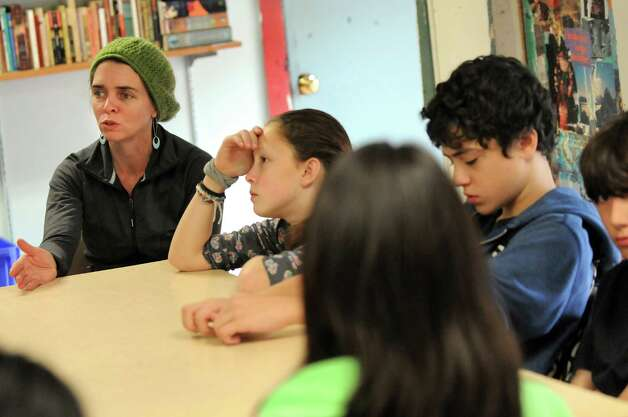 Middle-school teacher Rachael Littlejohn, left, speaks during a council meeting to resolve a problem involving students in grades six through eight on Wednesday, Nov. 5, 2014, at The Free School in Albany, N.Y. (Cindy Schultz / Times Union) Photo: Cindy Schultz / 00029346A
