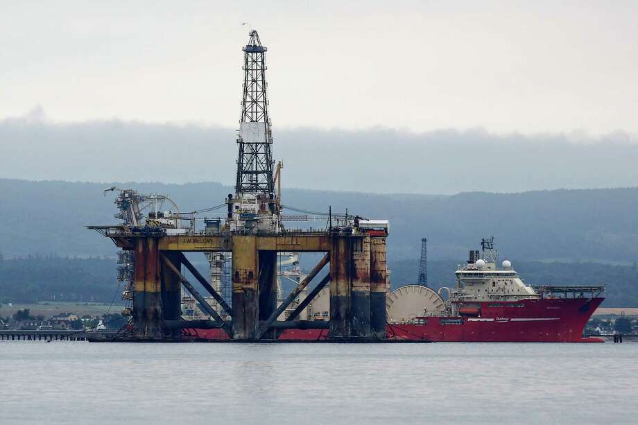The J.W. McLean oil drill rig, operated by Transocean, was anchored in the Cromarty Firth in August 2014. On Friday, the Swiss drilling contractor said its drilling machines are now worth billions of dollars less. Photo: Simon Dawson / © 2014 Bloomberg Finance LP.