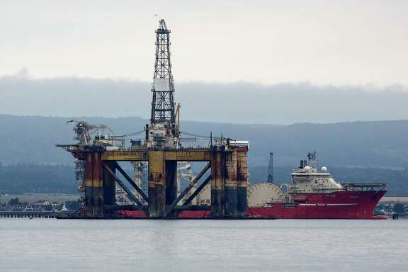 The J.W. McLean oil drill rig, operated by Transocean, was anchored in the Cromarty Firth in August 2014. On Friday, the Swiss drilling contractor said its drilling machines are now worth billions of dollars less.