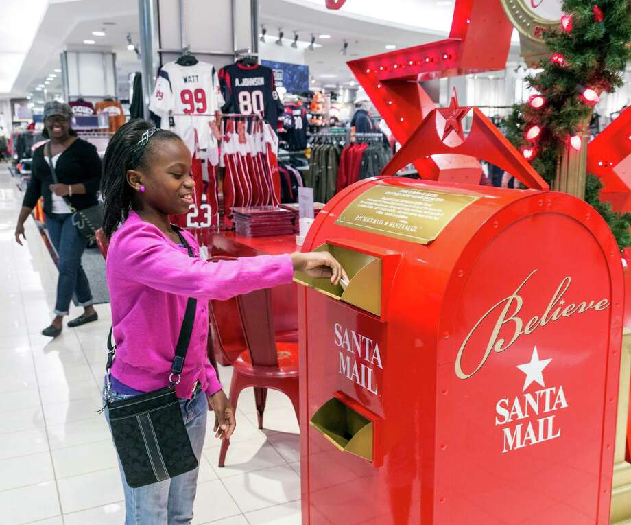 Autumn Roberts sends a letter off to Santa on Friday at Macy's in the Galleria.  Photo: Craig Hartley, Freelance / Copyright: Craig H. Hartley