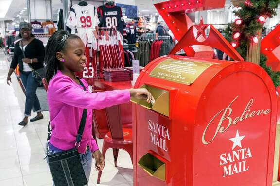 Autumn Roberts sends a letter off to Santa on Friday at Macy's in the Galleria.