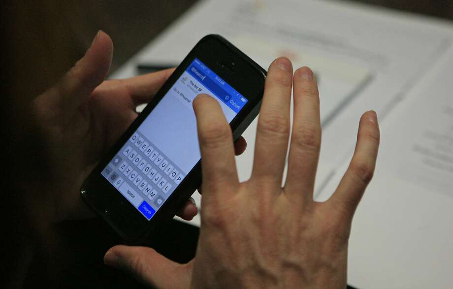 Val Wolf, engineering recruiter for Twitter, live tweets while holding mock interviews for clients with developmental disabilities at The Arc San Francisco on Howard Street in San Francisco, Calif. Friday, November 7, 2014. Photo: Jessica Christian, The Chronicle