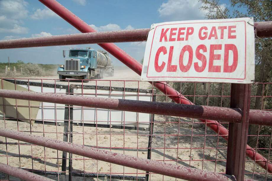 The disputed gate on Hindes Road is having a slow day if it sees 60 oil company trucks go by, guards said. Photo: J. Michael Short, FREELANCER / HOUSTON CHRONICLE
