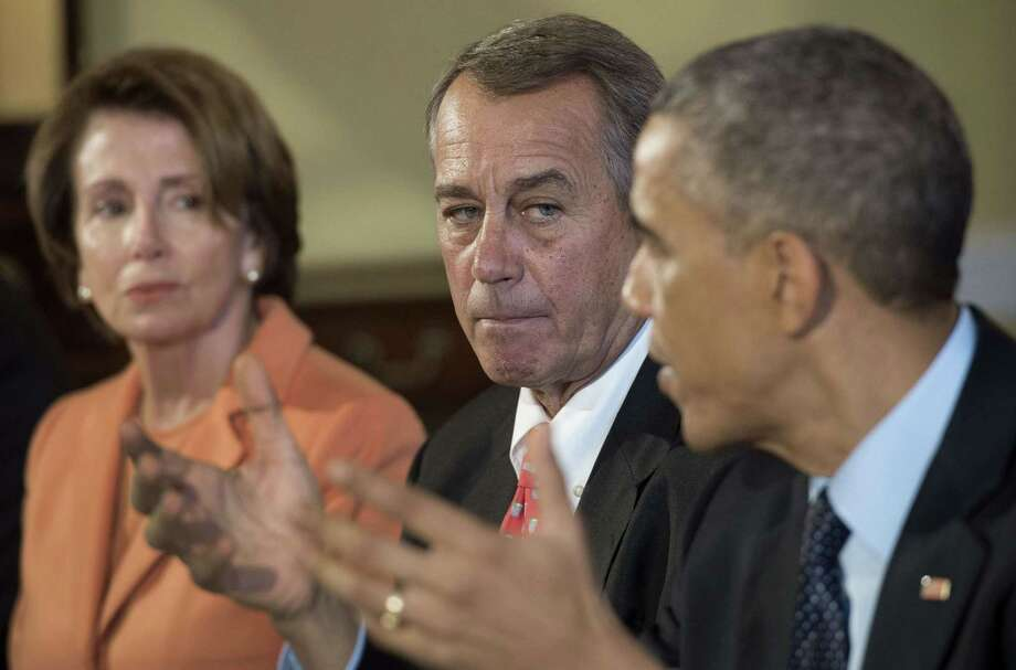 From left, House Minority Leader Nancy Pelosi, D-Calif.; Speaker of the House John Boehner, R-Ohio; and President Barack Obama were among leaders at a White House luncheon Friday aimed at cooperation after the midterm elections. Photo: JIM WATSON, Staff / AFP ImageForum