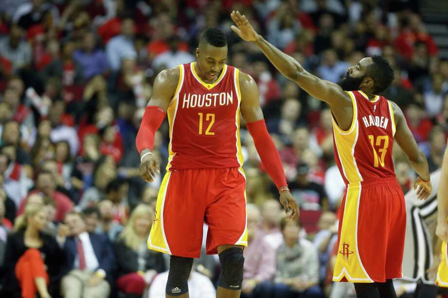 Center Dwight Howard, left, and guard James Harden have been a potent one-two punch for the unbeaten Rockets thus far this season. Photo: Cody Duty, Staff / © 2014 Houston Chronicle