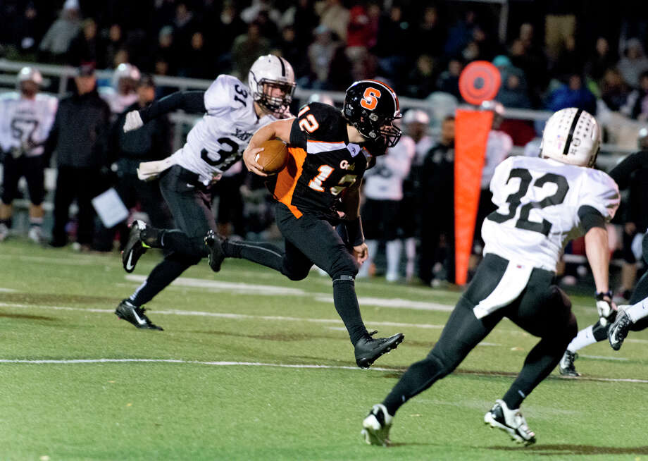 Shelton's quarterback Mark Piccirillo (12) carries the ball during the football game against Xavier High School at Shelton High School on Friday, Nov. 7, 2014. Photo: Amy Mortensen / Connecticut Post Freelance