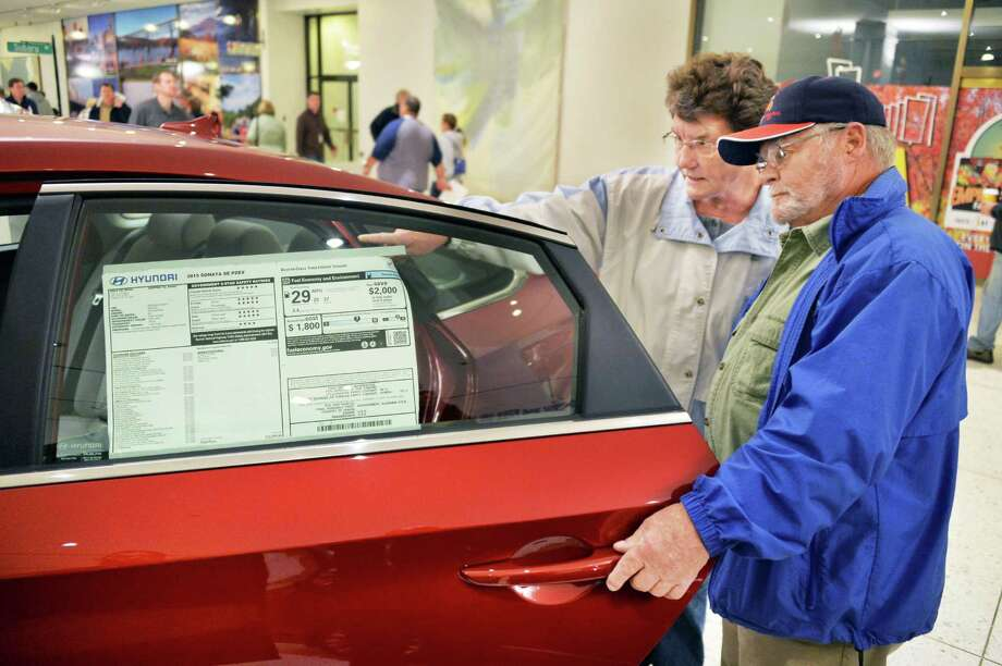 Carol and Dave Brown of Rotterdam check out a new 2015 Hyundai Sonata on the Empire State Plaza Concourse during the annual Empire State Plaza Auto Show Friday Nov. 7, 2014, in Albany, NY.  (John Carl D'Annibale / Times Union) Photo: John Carl D'Annibale / 00029293A