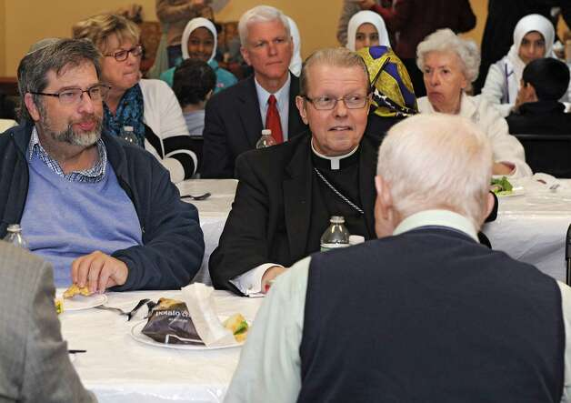 Rabbi Robert Kasman, left, sits next to Bishop Edward Scharfenberger as they visit the Islamic Center to have lunch and participate in a Prayer For World Peace on Friday, Nov. 7, 2014 in Colonie, N.Y. (Lori Van Buren / Times Union) Photo: Lori Van Buren / 00029299A