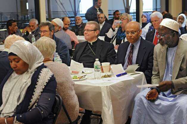 Bishop Edward Scharfenberger, center, visits the Islamic Center to have lunch and participate in a Prayer For World Peace on Friday, Nov. 7, 2014 in Colonie, N.Y. (Lori Van Buren / Times Union) Photo: Lori Van Buren / 00029299A