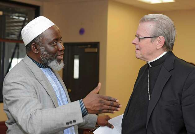 Iman Abdul-Rahman, left, talks to Bishop Edward Scharfenberger as the bishop visits the Islamic Center to participate in a Prayer For World Peace on Friday, Nov. 7, 2014 in Colonie, N.Y. (Lori Van Buren / Times Union) Photo: Lori Van Buren / 00029299A