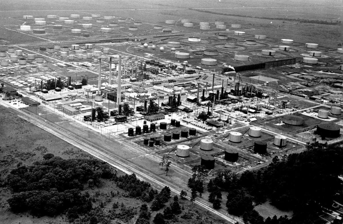 July 1941: At Shell's Deer Park refinery, the firm last December produced America's first barrel of toluene, a base for explosives, from petroleum. The $500,000 toluene plant is in the center of the photo, just behind and to the right of the three tallest towers. Shell has announced construction of a second and idential toluene unit, also to cost $500,000.
