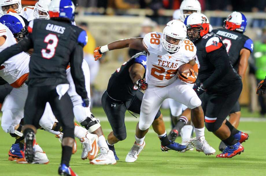 Malcolm Brown (28) finally got Texas' first triple-digit rushing day of the season last Saturday, running for 116 yards and two touchdowns against Texas Tech. Photo: John Weast, Stringer / 2014 Getty Images