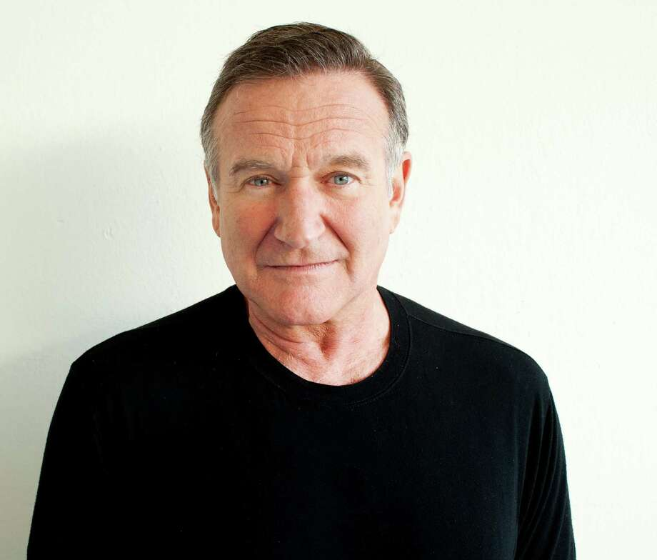 """FILE - In this Nov. 5, 2011 file photo, actor Robin Williams poses for a portrait during the """"Happy Feet"""" Press Junket in Beverly Hills, Calif. Authorities say an autopsy on Williams found no alcohol or illegal drugs in his system when he committed suicide at his Northern California home in August 2014. The Marin County sheriff's office released the autopsy results Friday, Nov. 7, 2014.  (Photo by Dan Steinberg/Invision/AP) Photo: Dan Steinberg, INVL / Invision"""