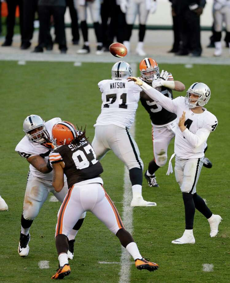 Donald Penn (left), Menelik Watson (71) and the rest of Oakland's offensive line have protected Derek Carr (4) well. Photo: Tony Dejak / Associated Press / AP