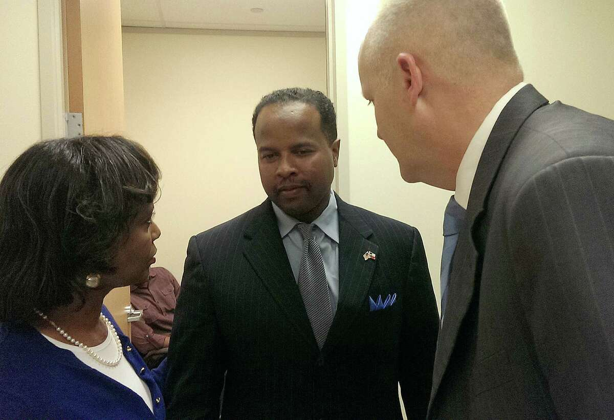 State Rep. Ron Reynolds talks with his attorneys Vivian King and Stephen Jackson after his 2014 conviction on six counts of misdemeanor solicitation of clients, a lesser charge than the felony barratry charge he faced. A judge set aside those convictions, but Reynolds was convicted in November, 2015 of five counts of the same offense and sentenced to a year in jail and a fine.
