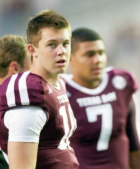 Texas A&M Aggies backup quarterback Kyle Allen, left, and quarterback Kenny Hill, right, talk during warmups before an NCAA football game against the Rice Owls at Kyle Field Saturday, Sept. 13, 2014, in College Station. (Cody Duty / Houston Chronicle) Photo: Cody Duty, Staff / © 2014 Houston Chronicle