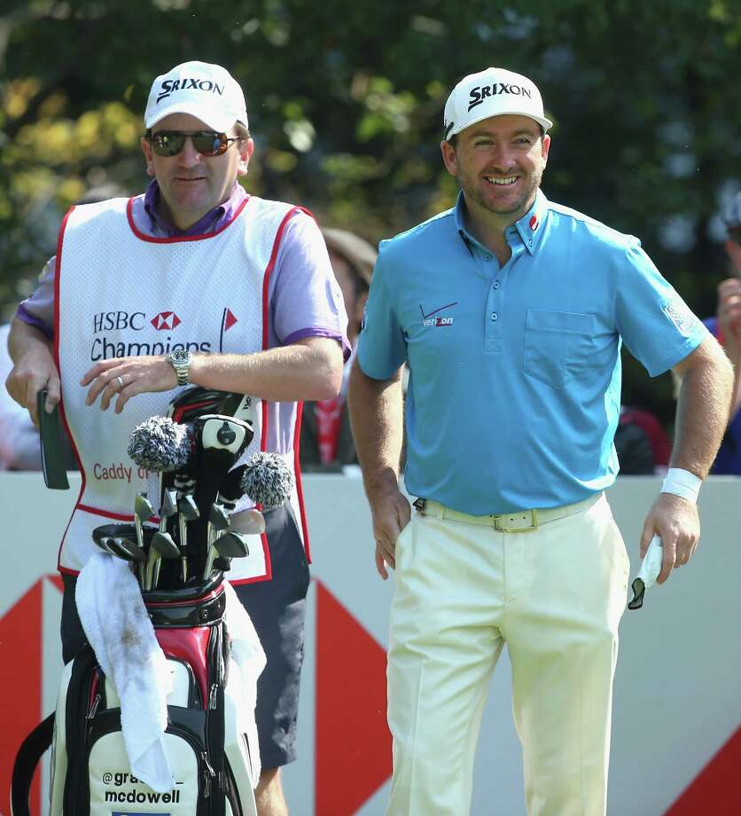SHANGHAI, CHINA - NOVEMBER 07:  Graeme McDowell of Northern Ireland stands with his caddie Ken Comboy on the first hole during the second round of the WGC - HSBC Champions at the Sheshan International Golf Club on November 7, 2014 in Shanghai, China.  (Photo by Andrew Redington/Getty Images) ORG XMIT: 517279153 Photo: Andrew Redington / 2014 Getty Images