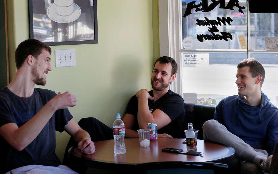 Ognjen Kuzmic, Andrew Bogut and Nemanja Nedovic meet at Aria Market for a taste of the Balkans. Photo: Brant Ward / The Chronicle / ONLINE_YES