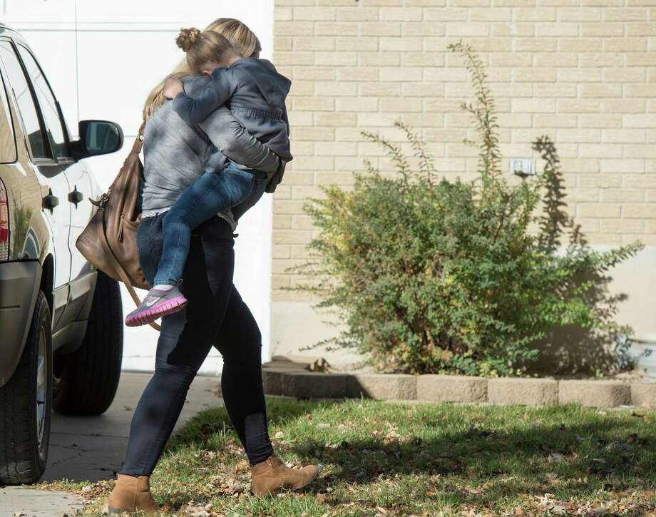 A Sandy family returns home with their daughter after the girl's father rescued her from a man who tried to kidnap her on Friday, Nov. 7, 2014, in Sandy, Utah. The Utah dad foiled an attempt to kidnap his young daughter from her bed early Friday after confronting a man carrying her across the lawn. (AP Photo/The Salt Lake Tribune, Rick Egan)  DESERET NEWS OUT; LOCAL TELEVISION OUT; MAGS OUT Photo: Rick Egan, MBI / The Salt Lake Tribune