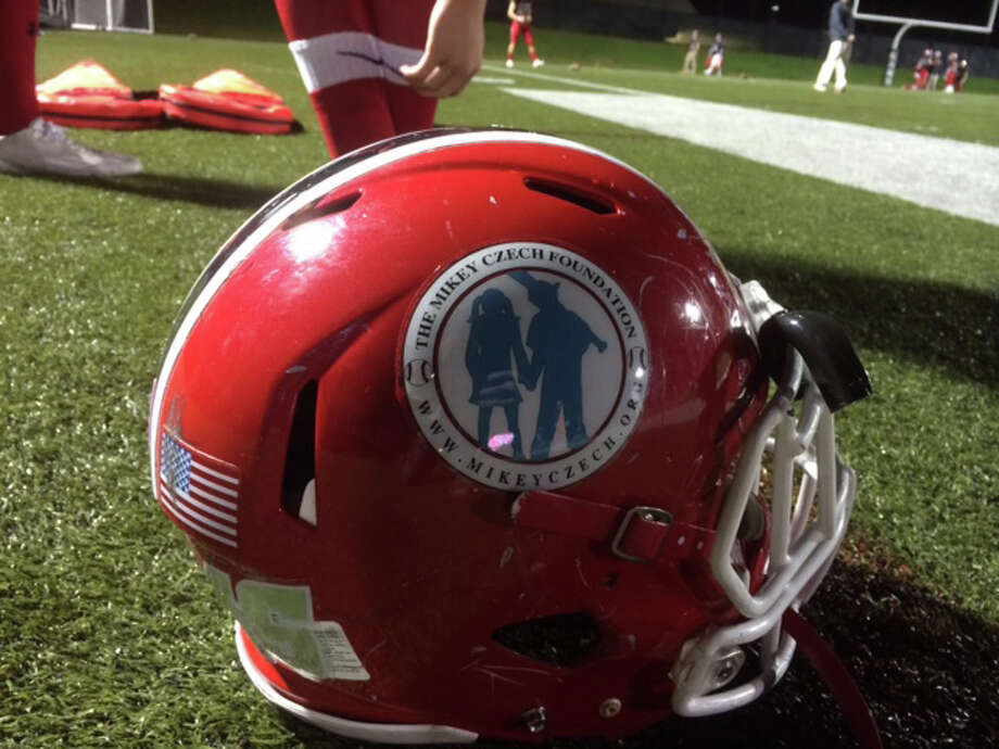 """A New Canaan football helmet with the """"Mike Czech Foundation"""" logo. Photo: Scott Ericson, File Photo / Stamford Advocate File Photo"""
