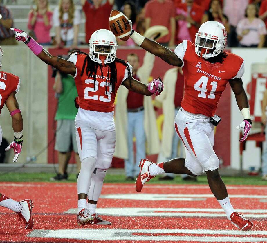 UH sophomore linebacker Steven Taylor, seen here after recovering a fumble during a victory over Temple on Oct. 17, has been a playmaker on defense this season. Photo: Eric Christian Smith, Freelance / 2014 Eric Christian Smith
