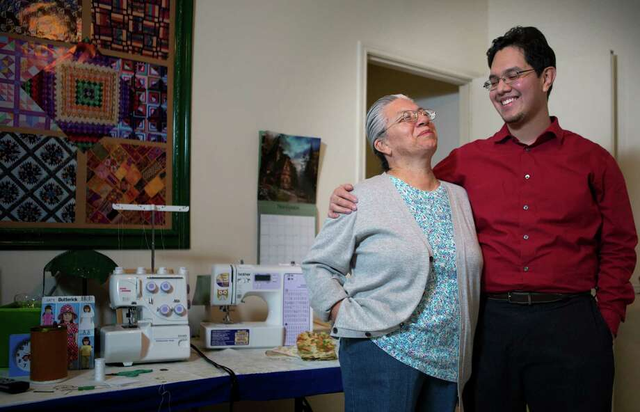 Eridani Alcantar, a UT graduate and high school math teacher, attributes his success to his mother, Esther, who put his education first. Photo: Cody Duty, Staff / © 2014 Houston Chronicle
