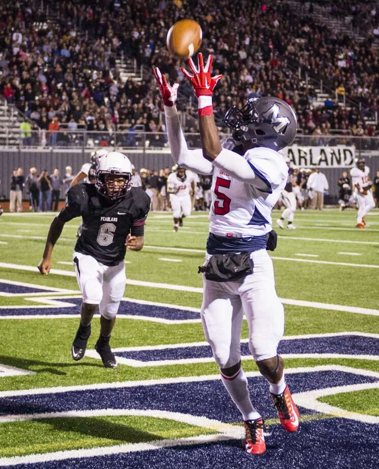 Manvel receiver Reggie Hemphill-Mapps (5) hauls in a touchdown pass as Pearland cornerback Isaiah Chaney (6) defends during the second half of a high school football game at  The Rig, Friday, Nov. 7, 2014, in Pearland. ( Smiley N. Pool / Houston Chronicle ) Photo: Smiley N. Pool, Houston Chronicle