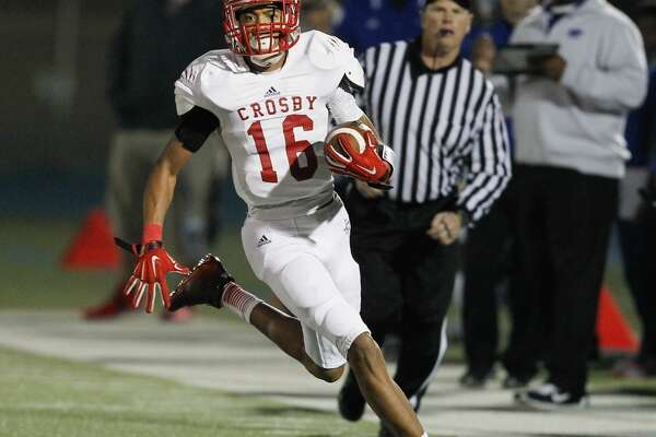 Crosby's Manny Netherly rushes for big yards after a catch during game action between C.E. King and Crosby, Friday, November 7, 2014. (Bob Levey/For The Chronicle)