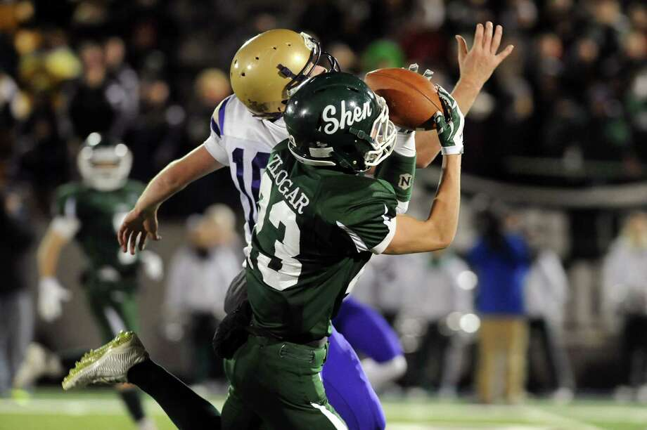 Shen's Jordan Zlogar, right, intercepts a a pass intended for CBA's Donald Vivian in their Class AA Super Bowl on Friday, Nov. 7, 2014, at Bob Ford Field in Albany, N.Y. (Cindy Schultz / Times Union) Photo: Cindy Schultz / 00029384A